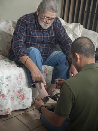 caregiver_tying_shoes.jpg
