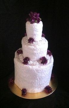 Towel Cake with Purple Flowers