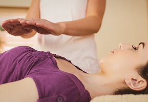Young%20woman%20having%20a%20reiki%20tre