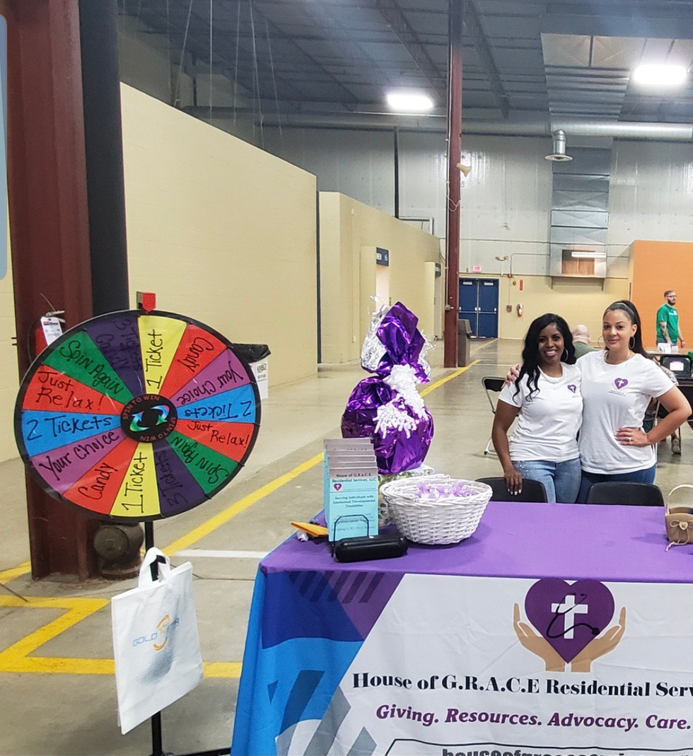 CEO & COO at community event representing House of G.R.A.C.E.