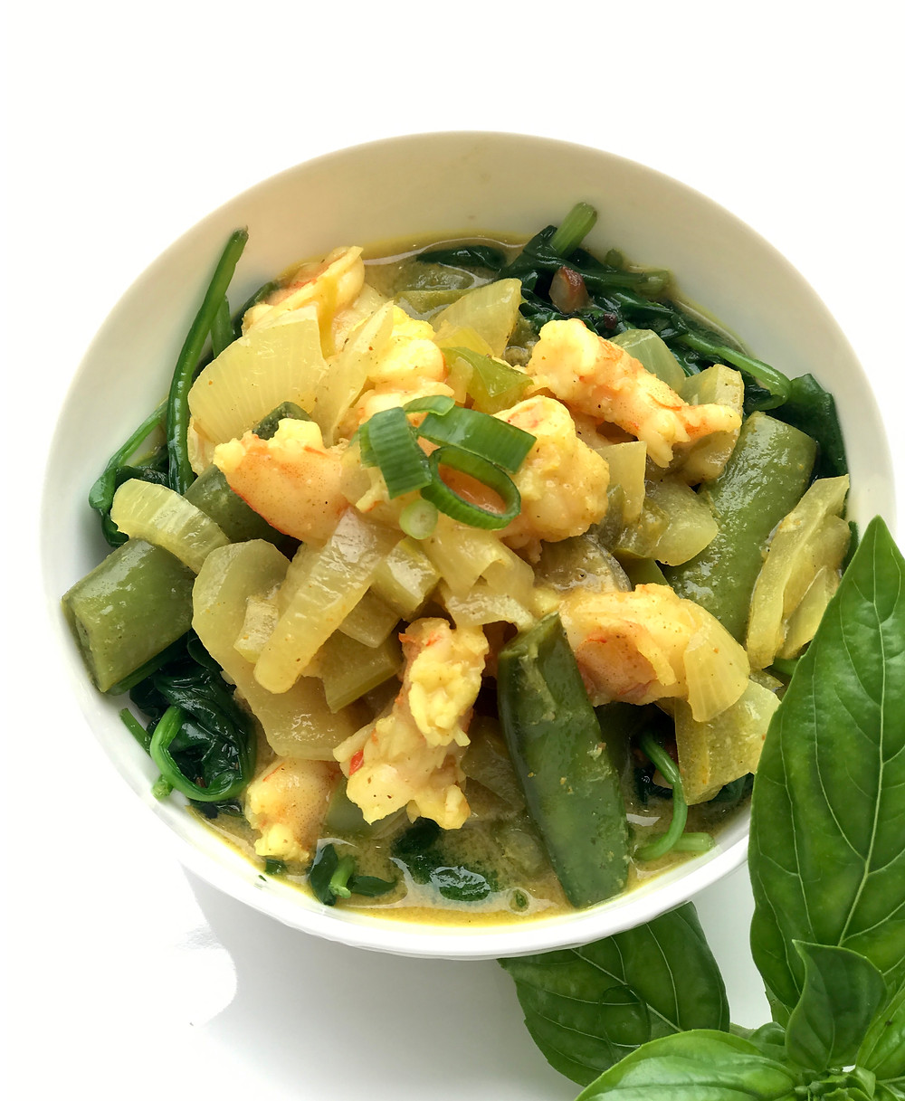 Curry over Steamed Spinach