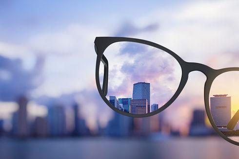 Modern bright city view through eyeglass