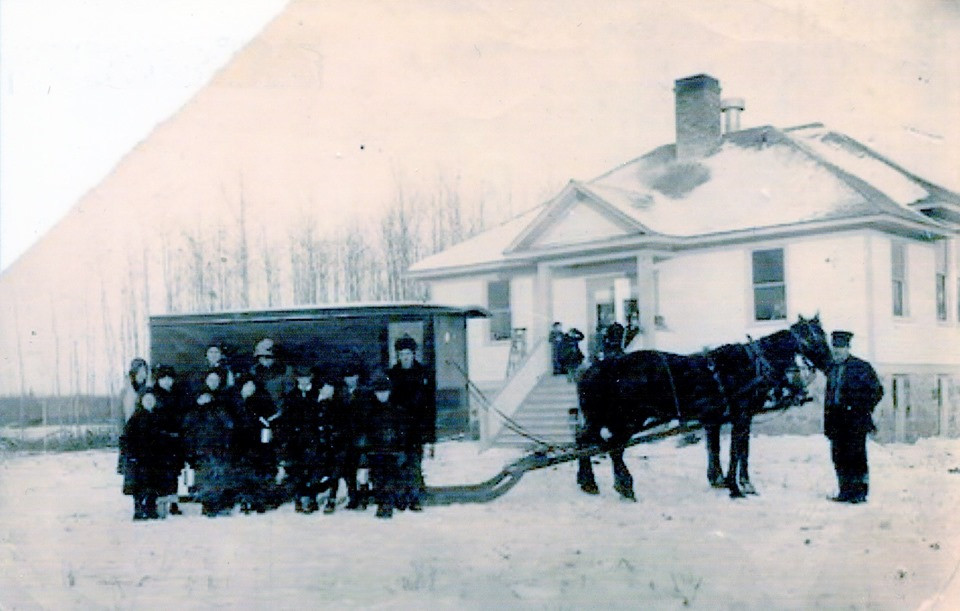 This horse drawn school bus is photographed outside the Birchdale School. It's driver is believed to be Olaf A. Nelson.