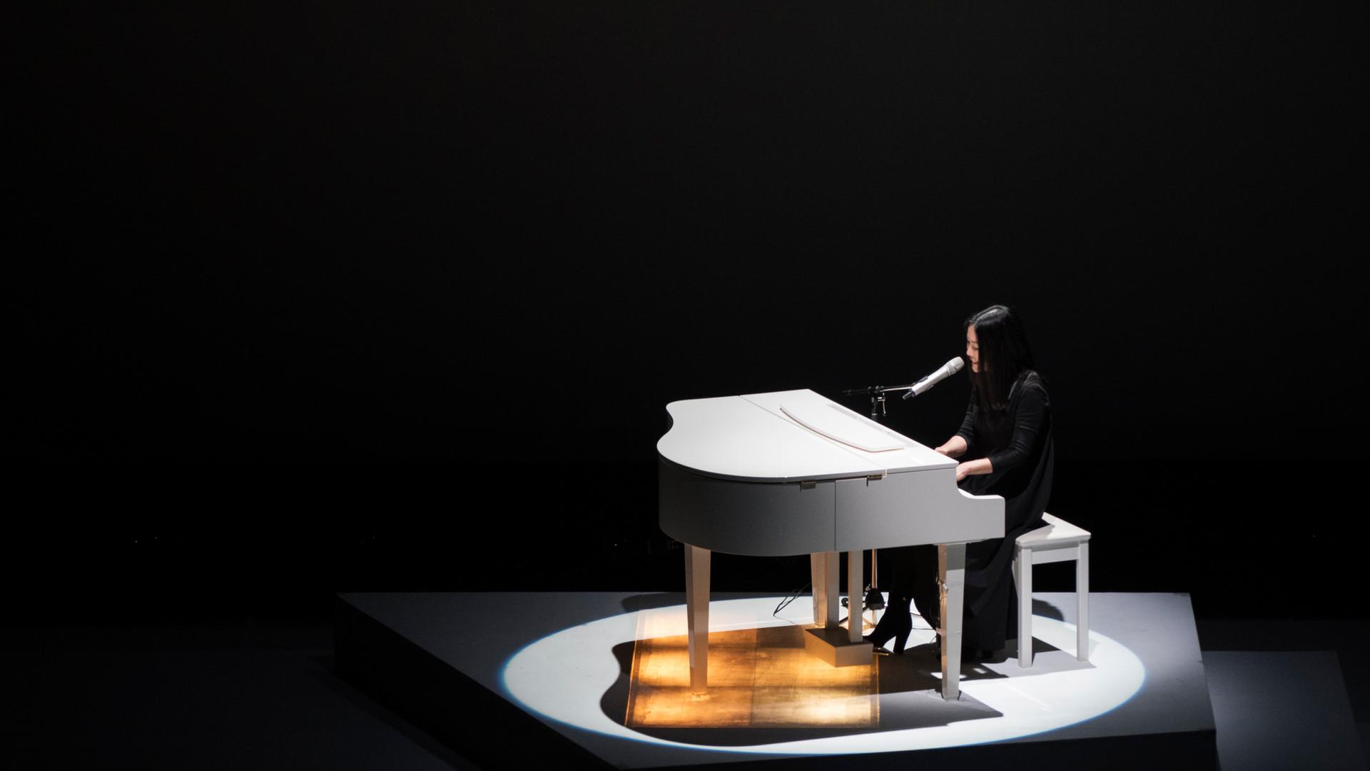 Imee Ooi with white piano