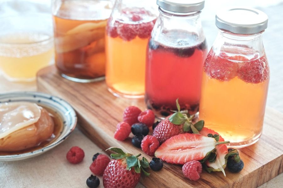 Jars of Kombucha and fruit