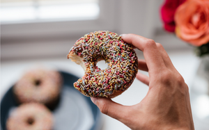 Holding a processed doughnut