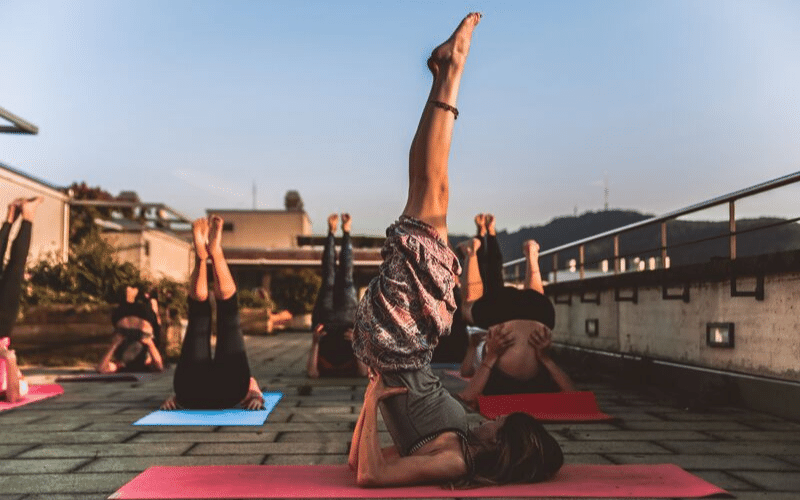 Women doing Yoga on rooftop