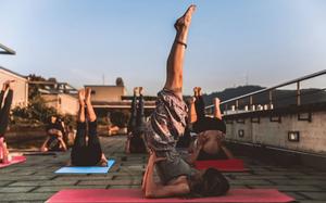 Women doing Yoga on rooftop