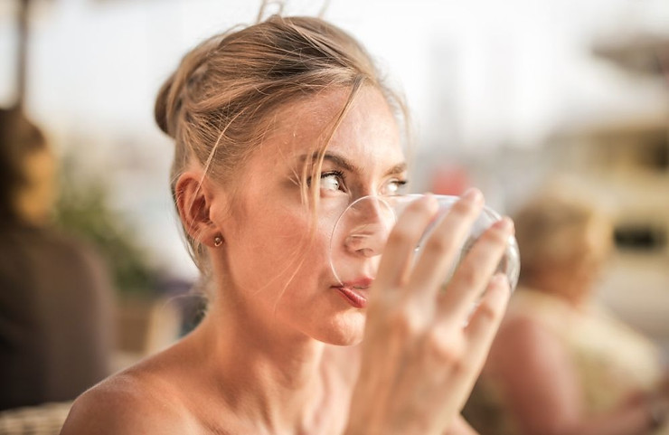 Woman drinking from a glass