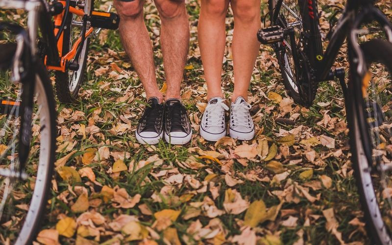 Woman and Man Cycling in Autumn