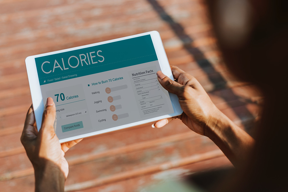 Girl reading a calorie counting app