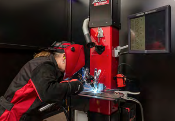 Skilled worker student practicing welding