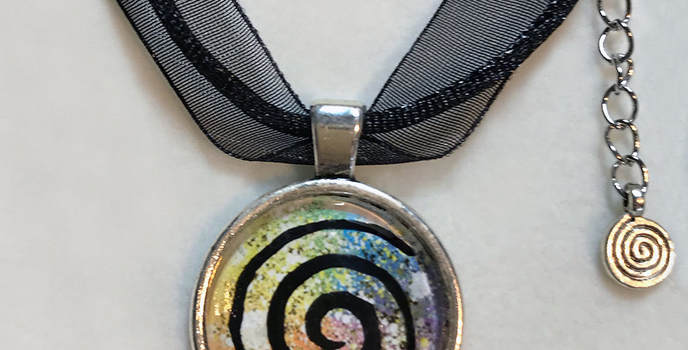 Spiral pendant with charm