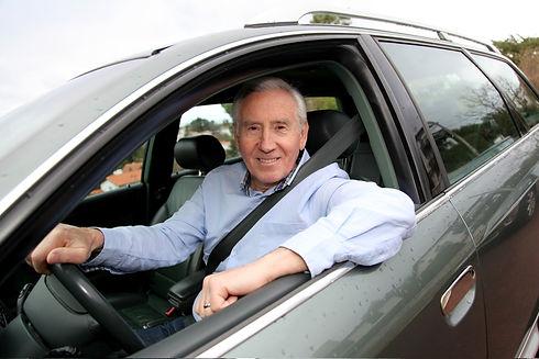 Elderly man driving a car.jpg