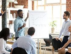 employees-discuss-presentation-of-infras