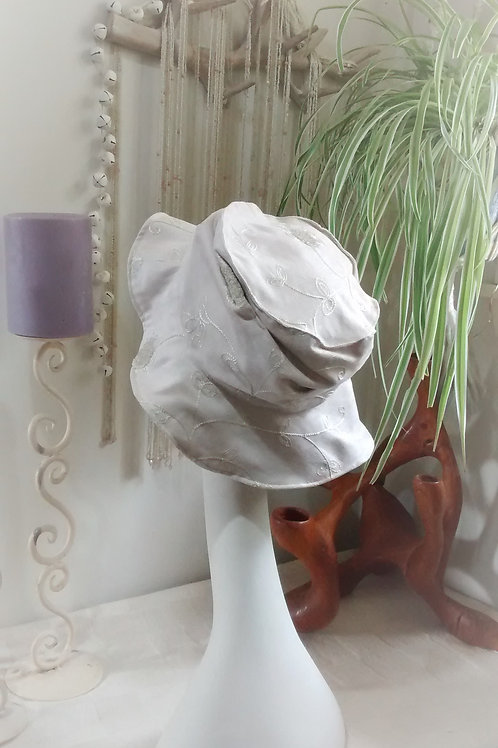 Embroidered swirls - recycled hat