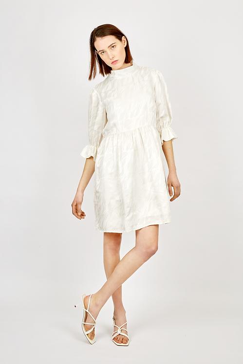 White silk dress with ruffled sleeve