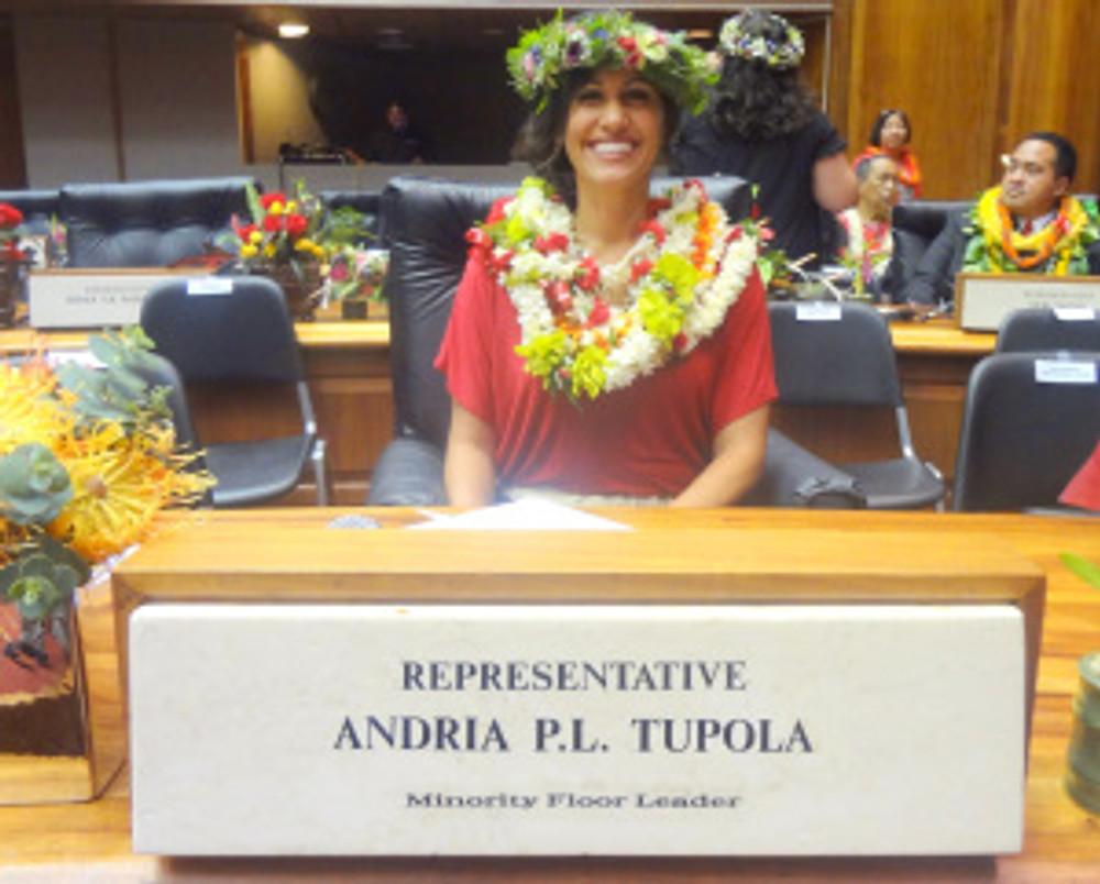 Rep Tupola at desk Chamber