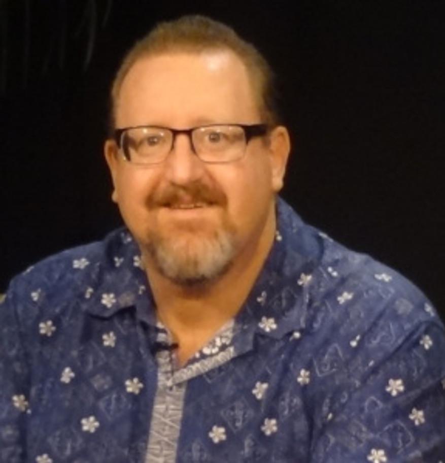 McDermott Head shot blue shirt