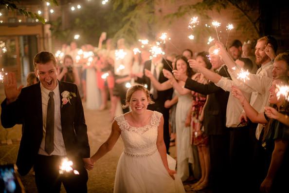 happy couple leaving wedding
