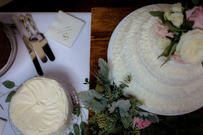 two cakes and greenery