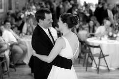 mr and mrs first dance while guests watch