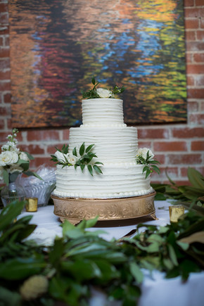 wedding cake with magnolia and greenery
