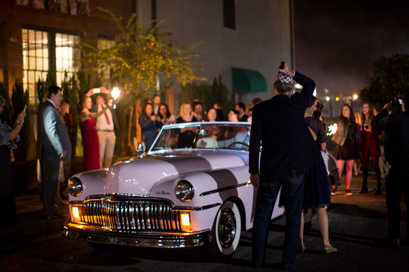 classic car send off with bride and groom