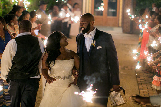 couple smiling sparkler sendoff