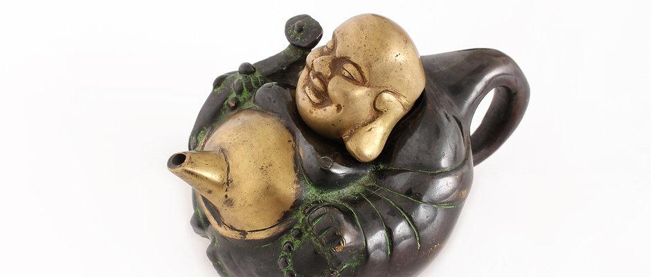 Arbatinukas besijuokiantis Buda