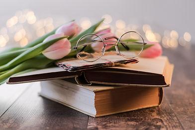 Canva - Eyeglasses On A Book.jpg