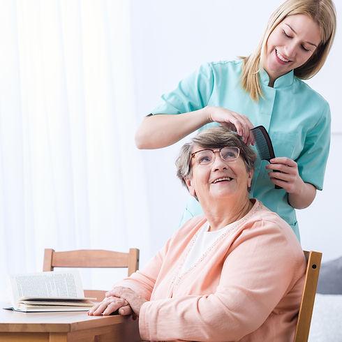 Image of caregiver take care of senior p