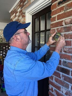 Randy installs a new porch light fixture
