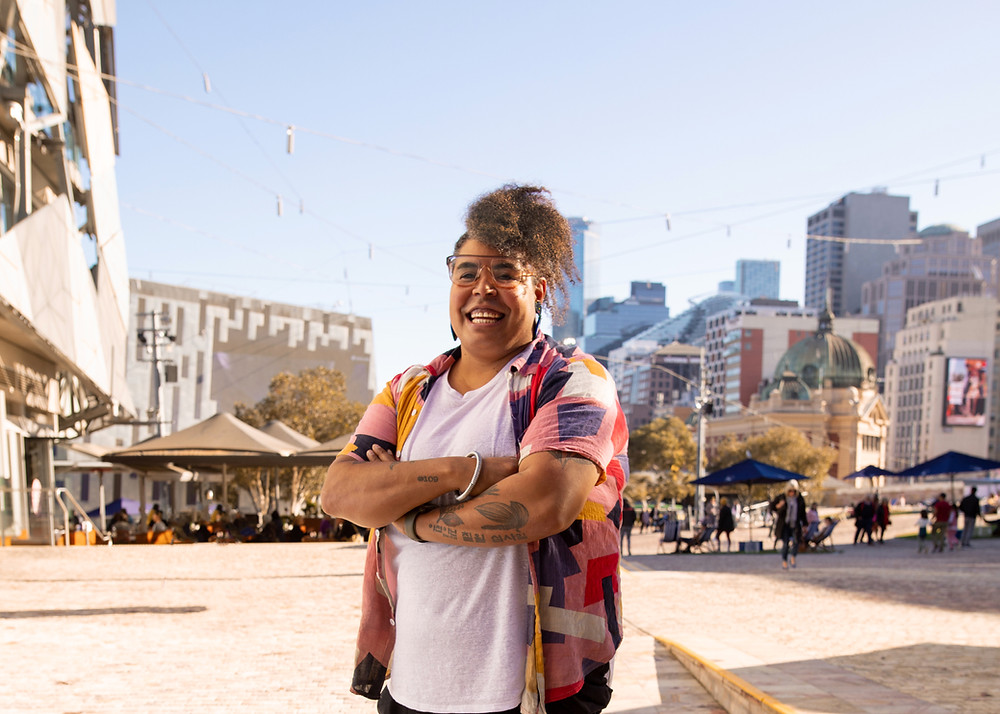 Owner of Mabu Mabu standing in Federation Square, Melbourne
