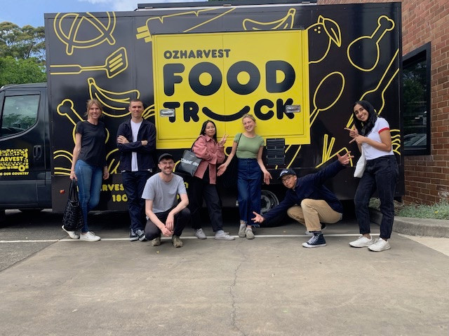 The Frost team gather in front of the OzHarvest truck.