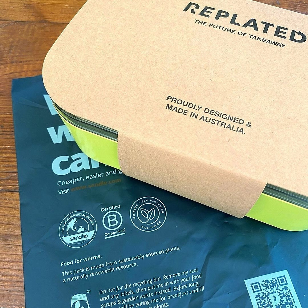 A RePlated container and its compostable mailing satchel.