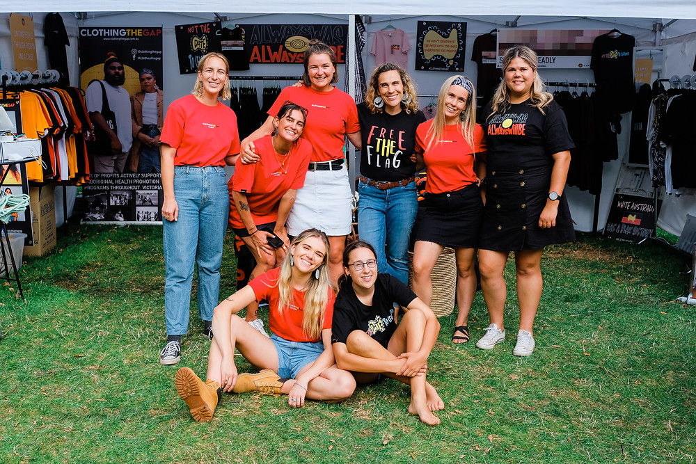 Clothing the Gaps team photo at a market stall