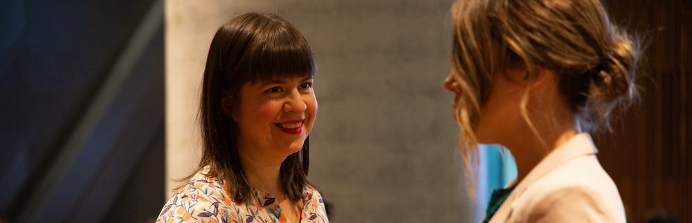 Two woman talking at an event