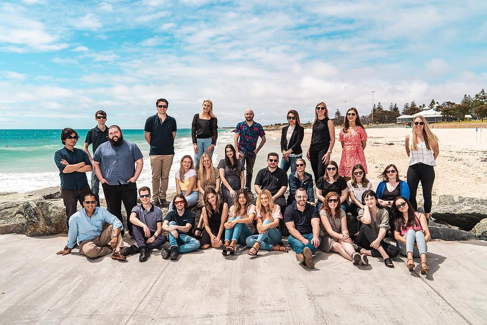 Veritas group team photo on beach
