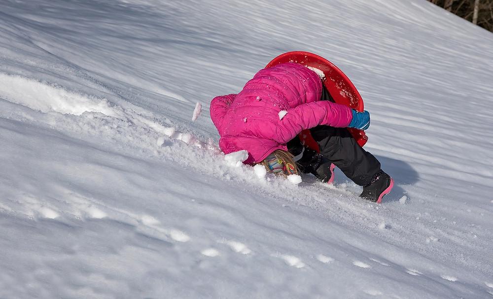 Girl falling in snow