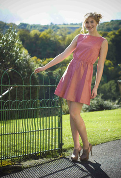 Dress with contrasting coral pure wool top and dupion silk skirt in burnt pink a
