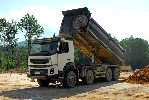 big tipper truck unloading land on the s