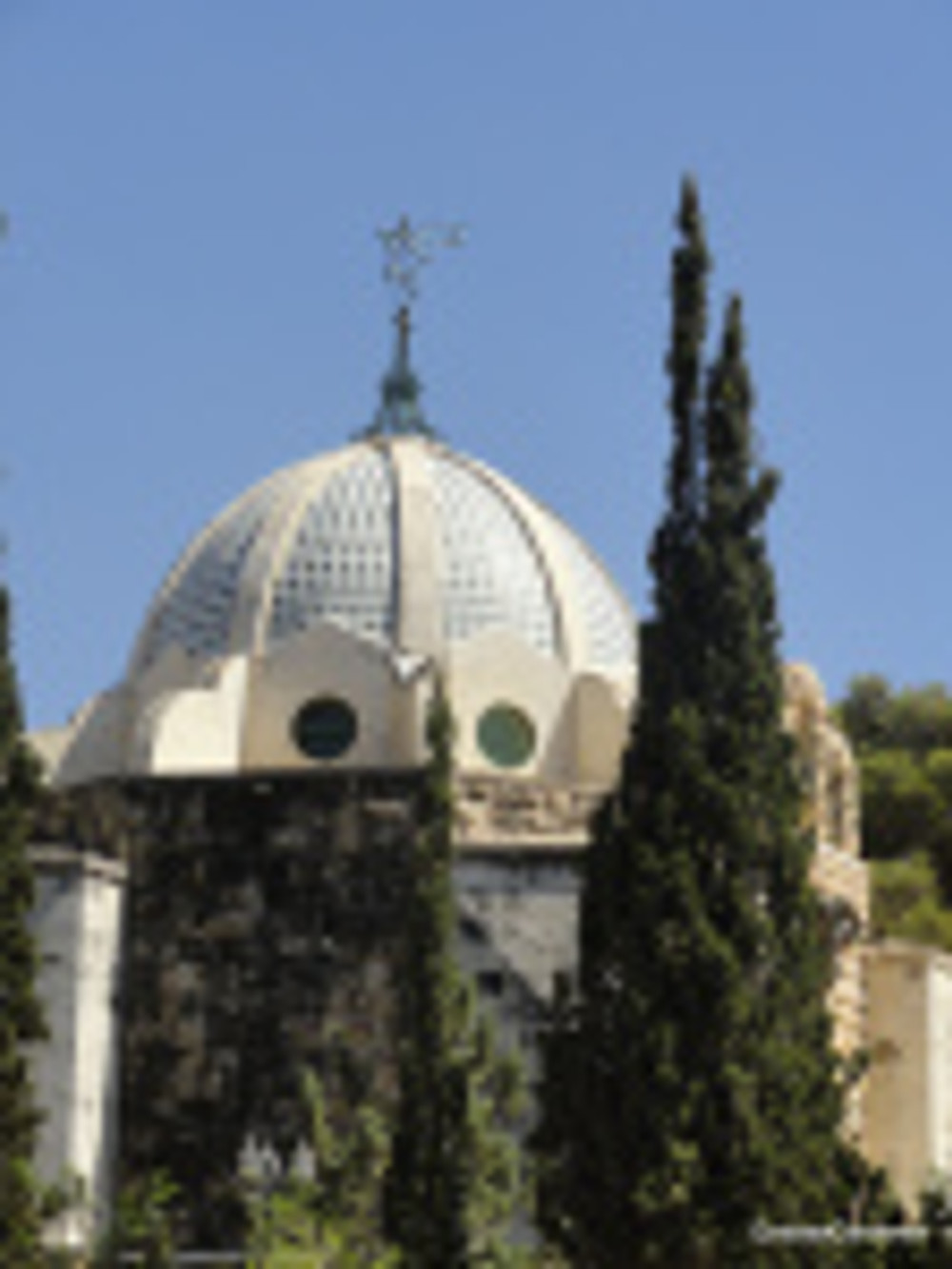 Cypress trees outside mausoleum in Jerusalem