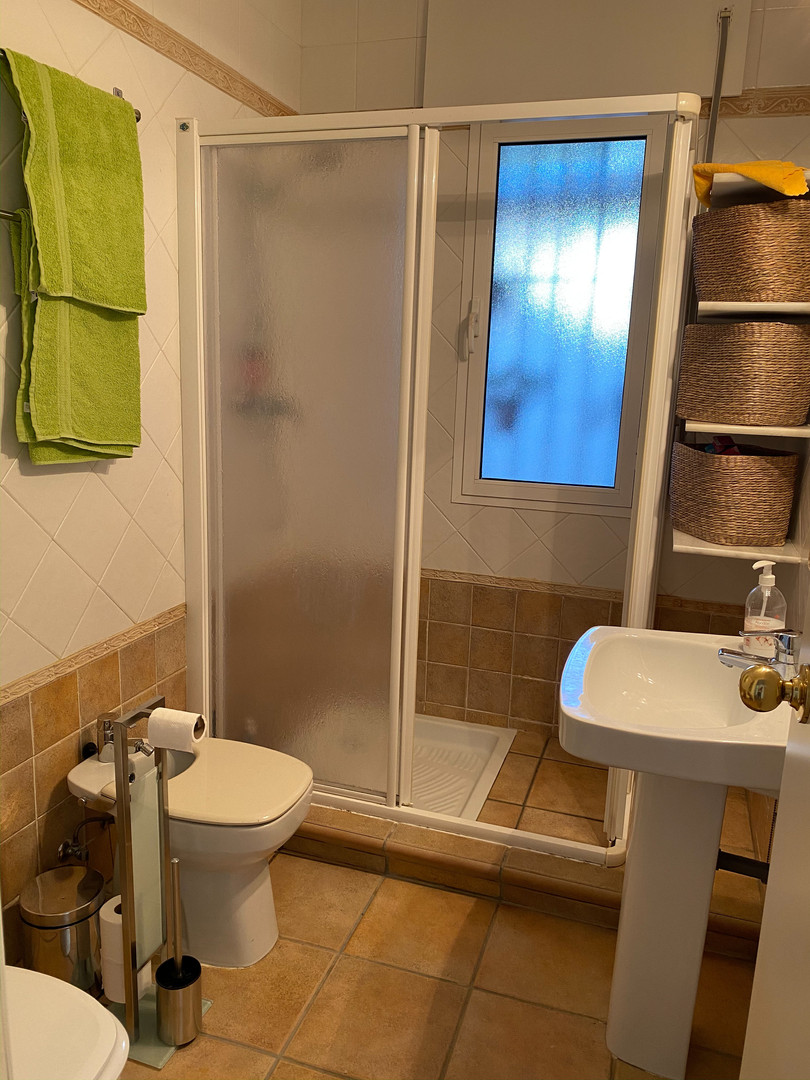 Bathroom with shower panel