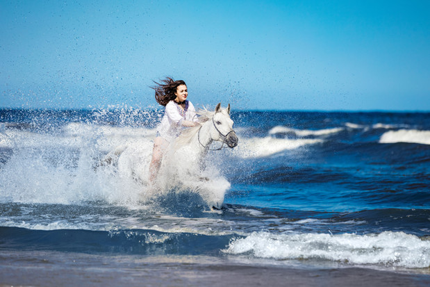 girl-on-a-white-horse-storming-through-t