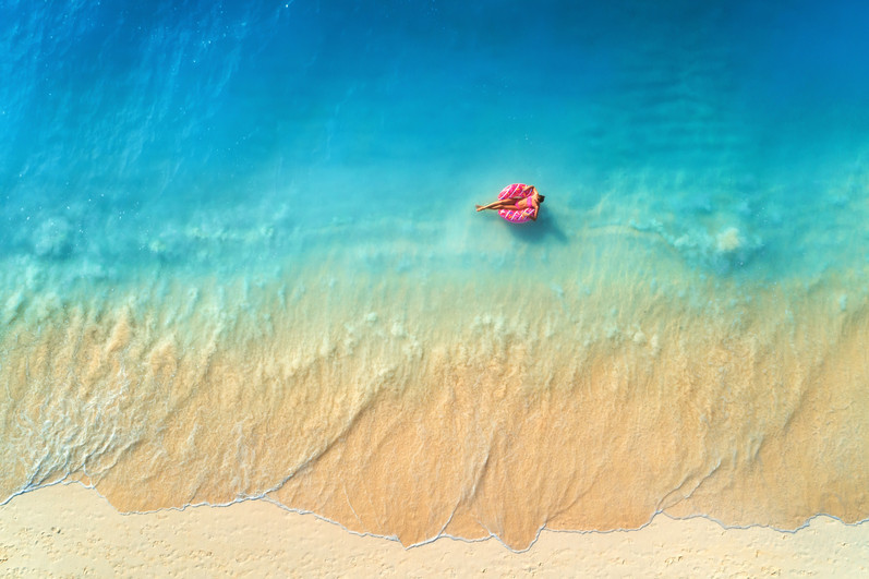 aerial-view-of-a-young-woman-swimming-wi