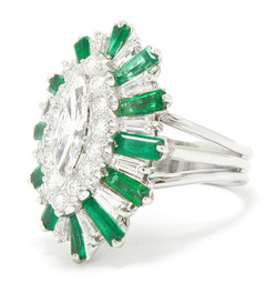 A marquise diamond ring set with gemstone accents.