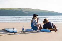 Enjoying a glass of wine on the beach Cornwall Surf Yoga Retreat Wild Free