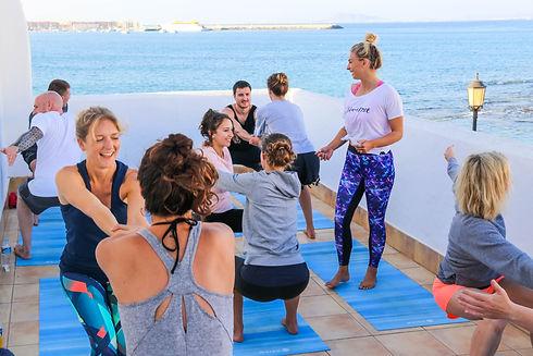 teaching yoga on in Fuerteventura with the ocean