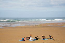 Yoga In Cornwall on the beach in Mawgan Porth